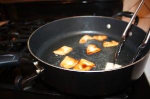 Brown tortillas in hot oil
