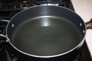 Place oil in pan and heat to 370 degrees