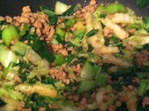 Step 3: Add pork to vegetables