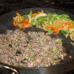 Cook meat and veggies