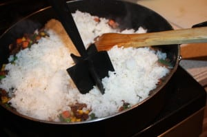Add rice, mash if needed to separate