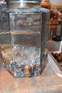 Glass pebbles or marbles in despenser