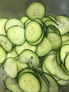 Layer cucumbers with salt